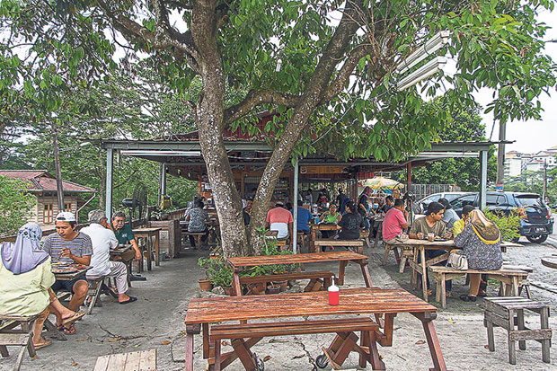 Onn Kitchen has a quaint Malay warong ambience, with a large tree growing at the front of the shop. — Pictures by CK Lim