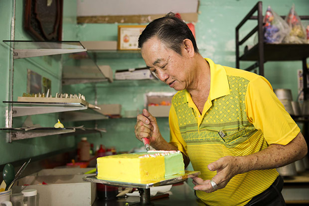 Cheng is very hands-on at the cake shop, decorating all the cakes himself.