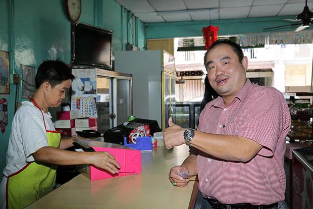 Loyal customer Elton Tan has been eating the pandan layer cake since he was 8 years old.