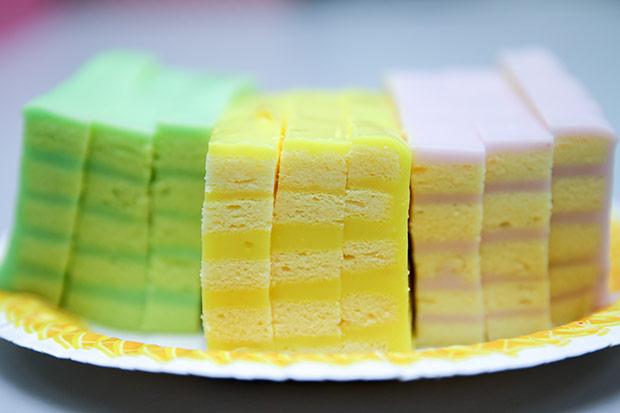 Pastel beauties in a row: pandan layer cake, corn layer cake and yam layer cake.