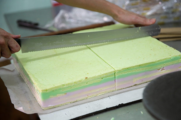 Once the cake is completed, it's cut into rectangle pieces.