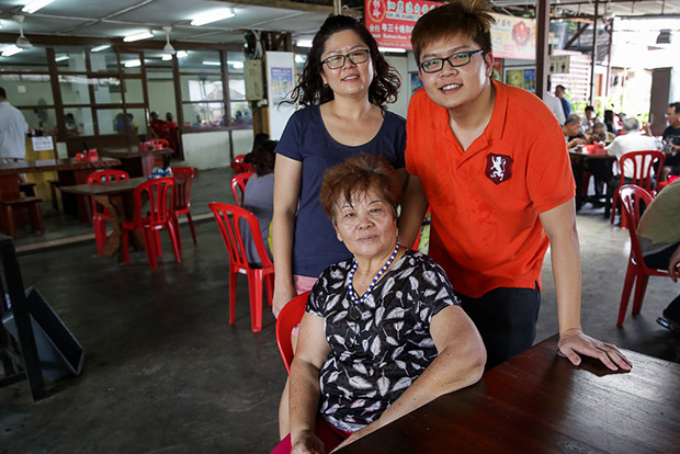 Karen Soh (middle) with her two children, Xan Ling and Marcus who also help out with the eatery.