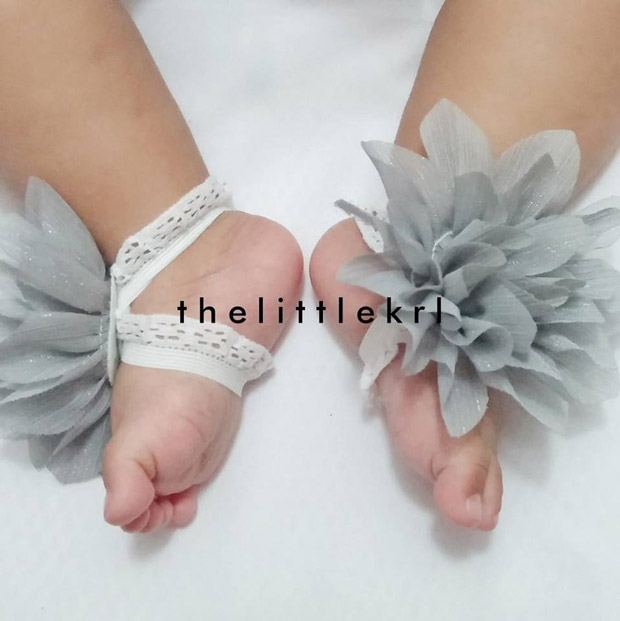 Dress up your babies with a pair of floral barefoot sandals.
