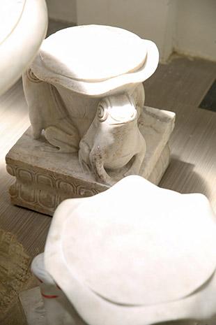Marble frog stools in Muhendaran Sri's courtyard.