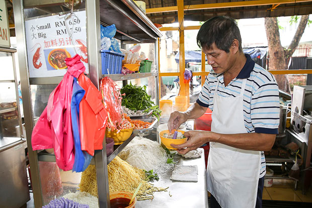Beh Teng Kooi started to learn making prawn mee from a young age when he was helping out in a stall back in his hometown, Nibong Tebal. — Pictures by Choo Choy May