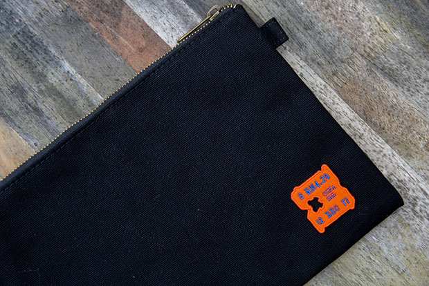 You can purchase a simple black clutch customised with Salang Design's best-selling roti patch.