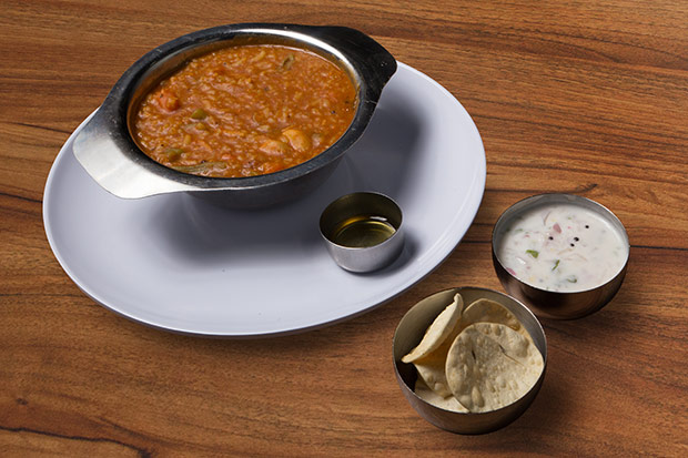 One spoonful of the bisi bele bhath or rice cooked with lentils and vegetables, is never enough.