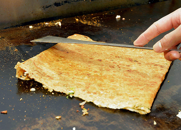 Once it is evenly brown, the onion dosa is ready to be served.