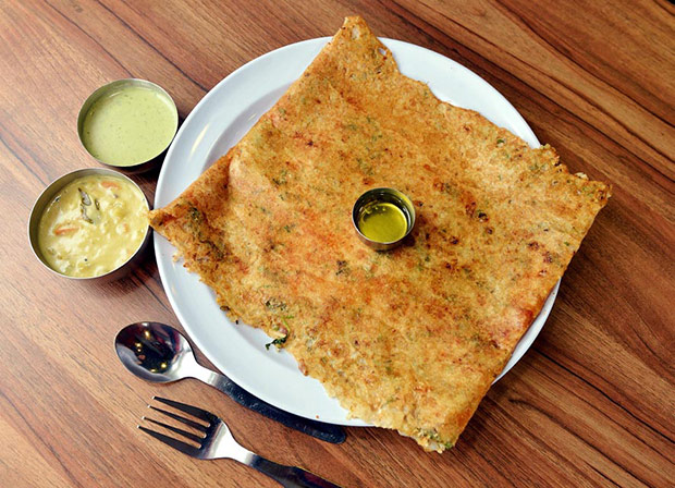 The ultra thin, crispy onion dosa is delicious with onions, chopped green chillies, coriander, cumin seeds and coconut.