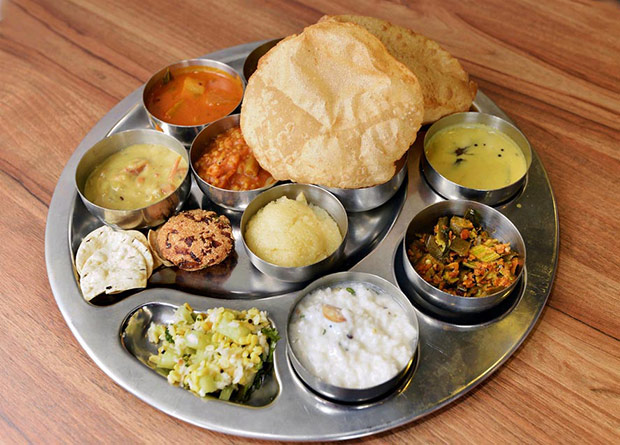 For lunch and dinner, you have the option to order these meals with a little bit of everything, from payasam, poori, rice and bisi bele bhath.