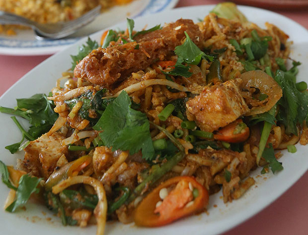 Deliciousness on a plate: Mee goreng with lots of punch from their own-made chilli sauce. – Pictures by Abdul Razak Ghazali