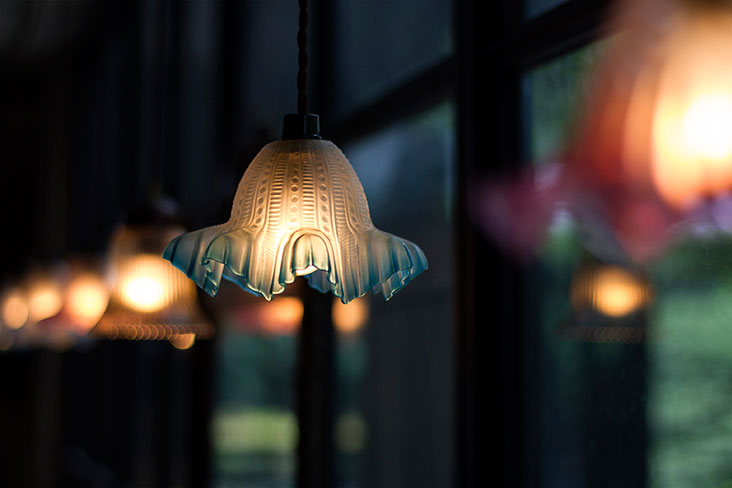 Low-hanging lamps at Some Time Blue create a romantic ambience