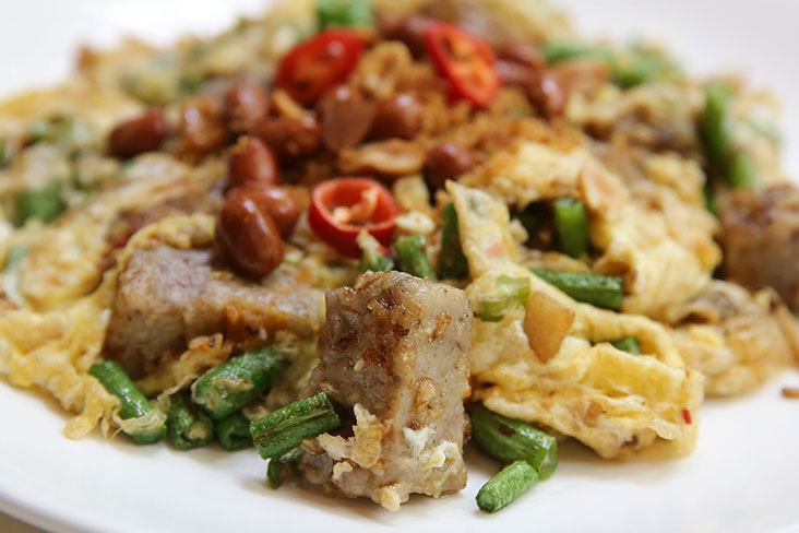 Bite on this stir fried yam made with cubed yam cake, egg and garnished with peanuts and dried prawns. – Pictures by Yusof Mat Isa