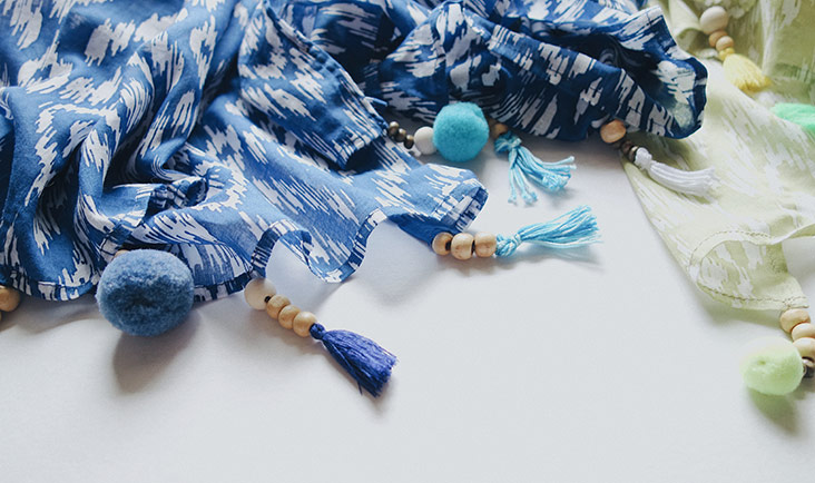 Nothing is prettier than this adorable combination of pom poms, tassels, beads and colourful batik for their range of pareos.