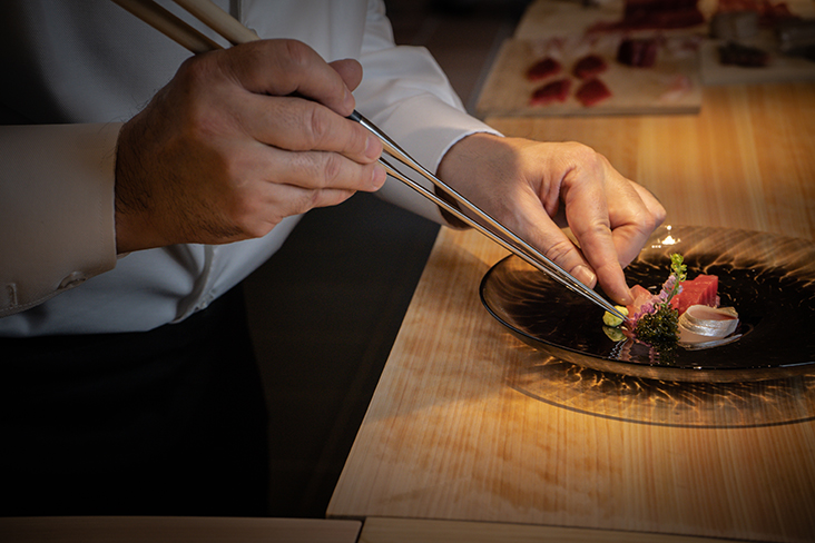 Chef Kiichi Okabe plates up the omakase course at Sushi Ryu
