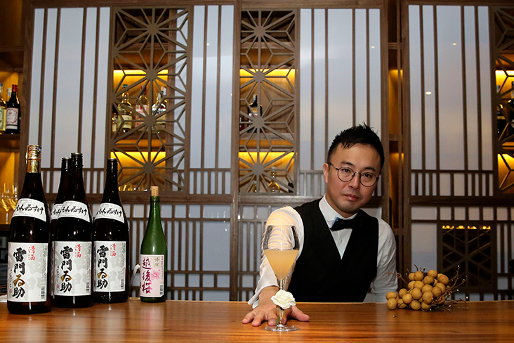Bar Shake's Osamu Kinugawa or Sam presents his longan saketini where the fresh fruit juice is infused with Junmaisho sake