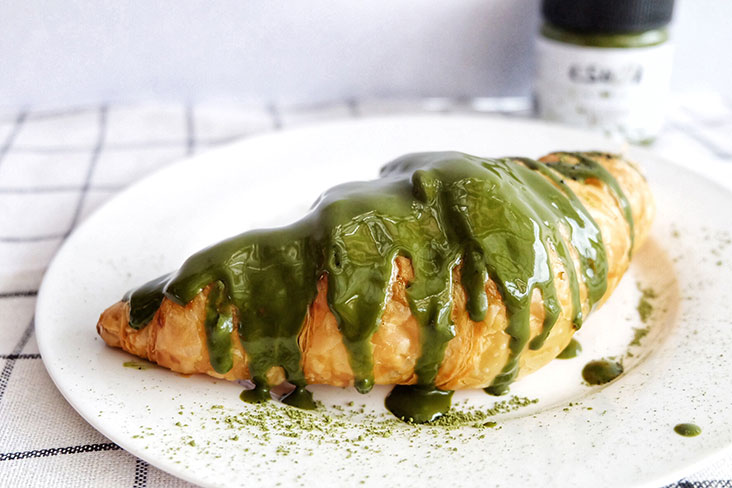 Drizzled on a freshly baked croissant, an artsy matcha pastry is born!