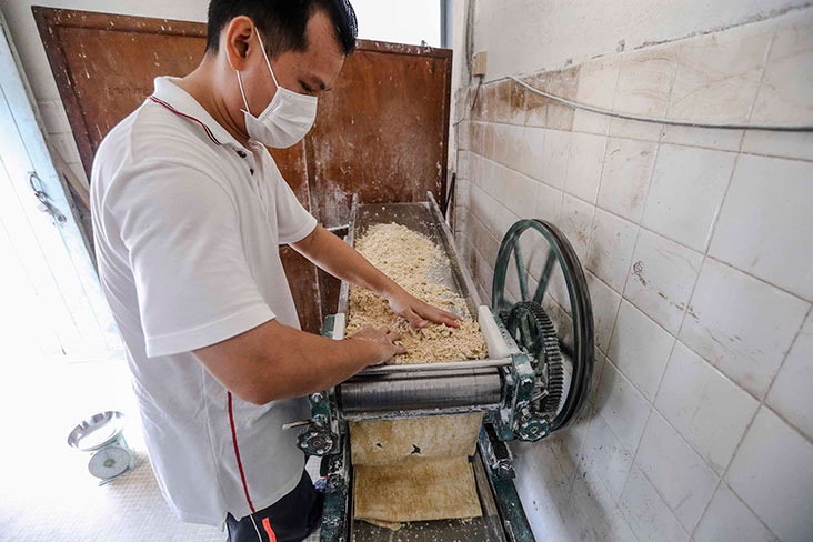 The dough is flattened into rough sheets.
