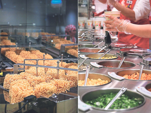 Instant noodles being fried in hot oil to remove its water content (left). Choose from various toppings and make your own customised cup noodles at the My Cup Noodles Factory! (right)