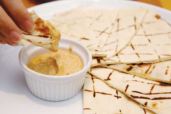 You won't be able to stop eating the addictive Carmelised Onion Hummus with the soft in-house baked Lebanese bread