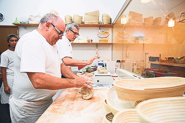Klaus Adolph is so skilled in baking that he can knead two portions of dough at one time