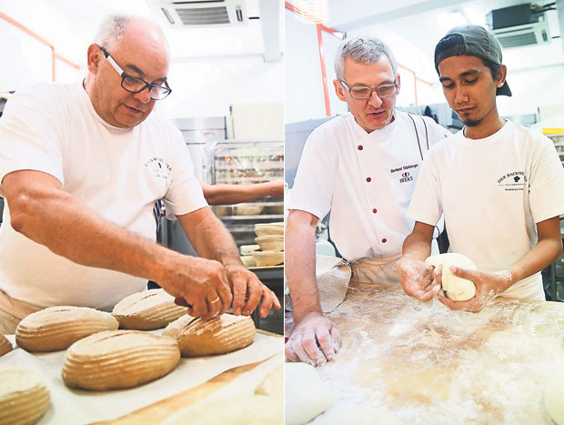 Klaus Adolph is Der Backmeister's consultant baker with 50 years of experience (left). Ireks Gerhard Stichlberger, a supplier for Der Backmeister's ingredients was at hand to teach their baker, Mohamad Shafik some new bread recipes (right)