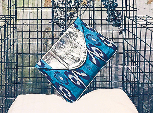 The J Ikat clutch features a leather flap for a touch of luxe