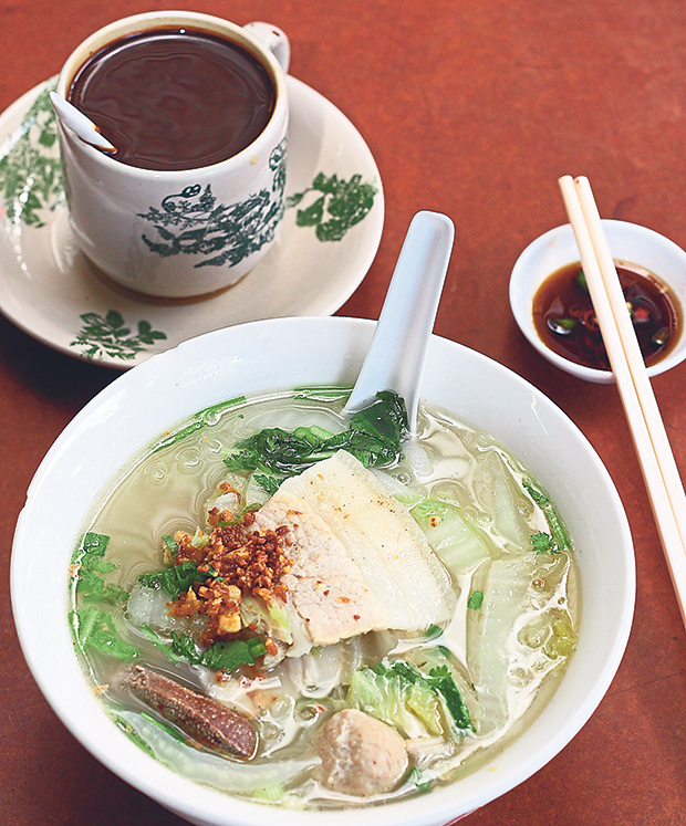 For something unusual, go for their pork noodles topped with pieces of pork belly slices. – Pictures by Lee Khang Yi