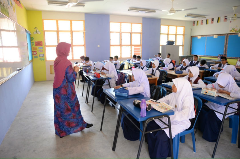Pupils attending their first day of school in Kuala Kangsar in this file picture taken on January 12, 2015. The police are launching an investigation in a report that a teacher punched a parent during a school registration session today. — Picture by K.E. Ooi