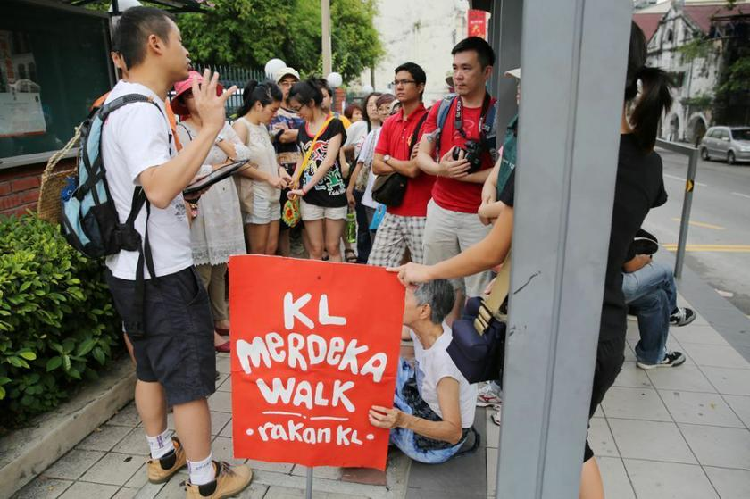 RakanKL has been conducting guided heritage walks not just  to raise awareness of heritage conservation but to defend heritage areas from the heavy construction currently underway. – Picture by Choo Choy May