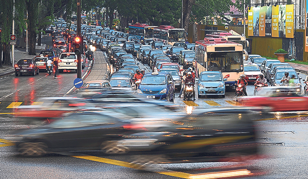 Tengku Adnan Mansor said that the government may prohibit 'kap chais' and other commuters from driving into the capital city once public transportation reaches a more reasonable price. — File pic