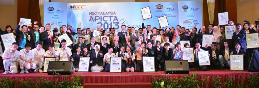 Sitting in the centre are MDeC chairman Abdul Halim Ali (fourth from left); Che Azemi Haron, Deputy Secretary General II, Ministry of Communications & Multimedia (fourth from right) and MDeC CEO Badlisham Ghazali (third from left); with judges, organisers and the winners and merit recipients of the 2013 APICTA Awards October 8 2013. — picture courtesy of Digital News Asia