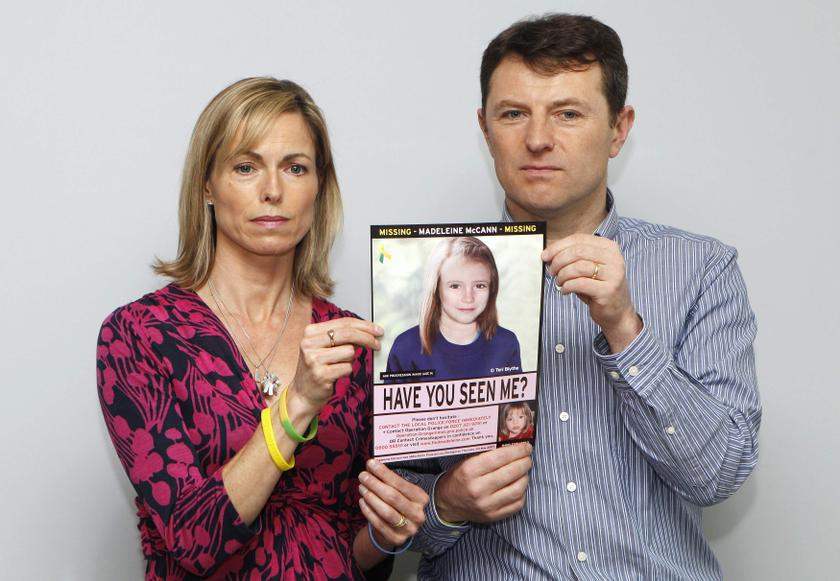 Kate and Gerry McCann are seen posing with a computer generated image of how their missing daughter Madeleine might look, during a news conference in London in this May 2, 2012 file photograph.  — Reuters pic