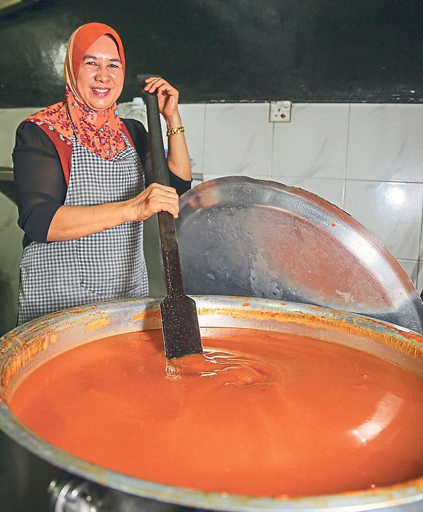 "Rohaya Sidan, the daughter of Tijah Yusof or ""Mak Jah"" runs the KL branch of Kuala Sepetang Mee Udang Mak Jah with her children"