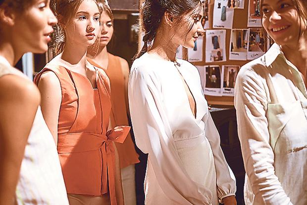 Models backstage at London Fashion Week