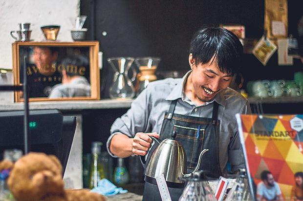 Barista Joachim Leong brewing coffee at Spacebar Coffee