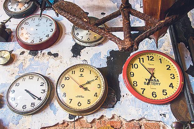 A wall of clocks at Junk Cafe