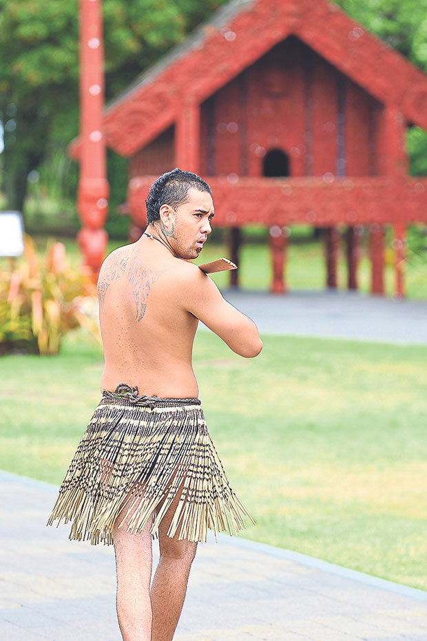 A cultural performer clad in the traditional piupiu at Te Puia
