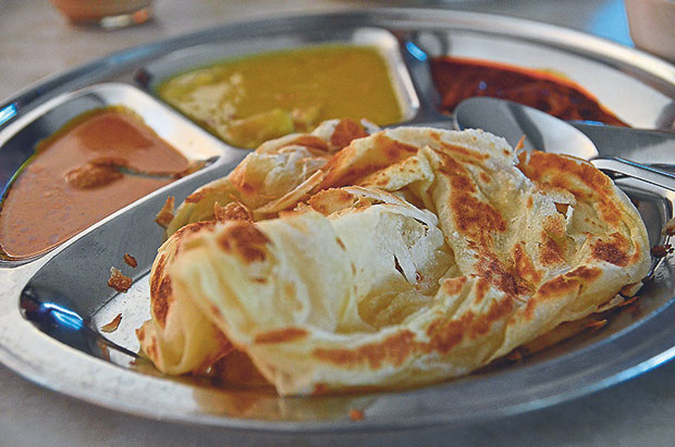 The roti canai served here is made fresh on the spot; the sardine sambal is spicy but complements the roti perfectly
