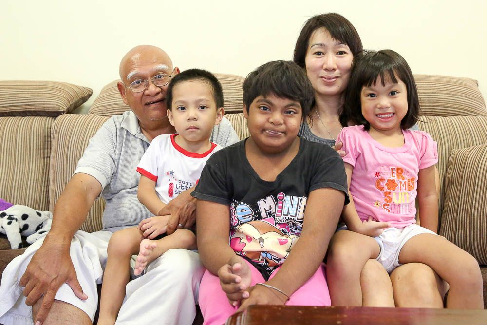 (From right, seated) Pastor Henry Martinus and his wife Serena Wong with Isaac, 5, Abigail,12, and Isabella, 4 — Picture by Choo Choy May