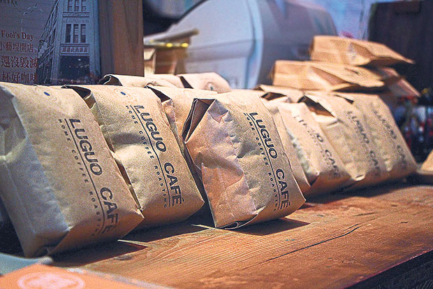 Luguo Café roasts and packs their own coffee beans for sale.