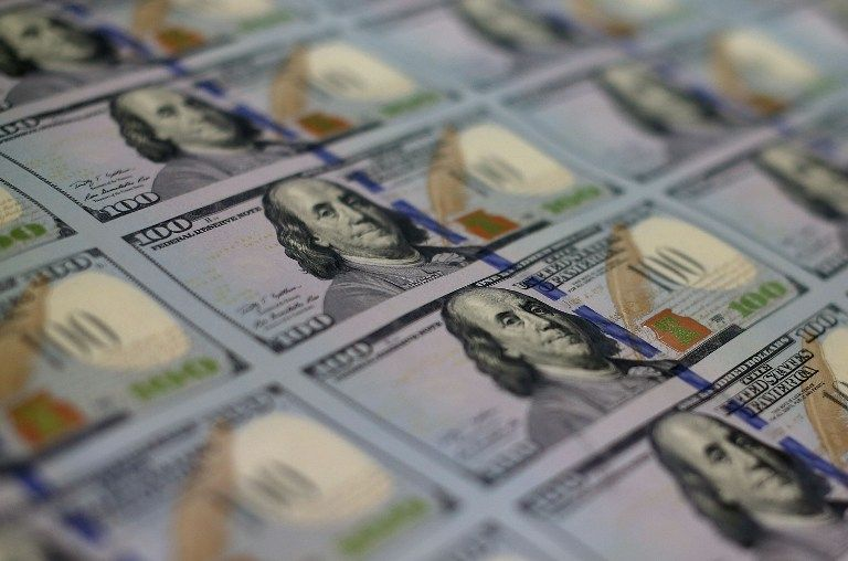 Newly redesigned US$100 notes lay in stacks at the Bureau of Engraving and Printing in Washington, DC. — AFP pic