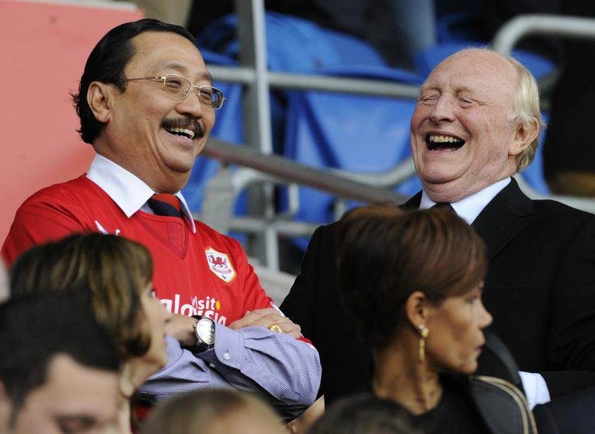 Cardiff City's owner Vincent Tan (left) laughs with former Labour Leader Neil Kinnock during their English Premier League football match against Newcastle United at Cardiff City Stadium in Cardiff, Wales, October 5, 2013. — Reuters pic