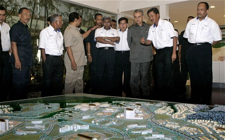 Former Malaysian Prime Minister Abdullah Ahmad Badawi being shown a diorama of the Iskandar development region in 2007. – AFP pic