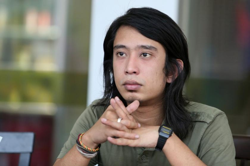 Social activist Adam Adli Abdul Halim scored a reduced sentence at the High Court today with a fine of RM5,000 instead of having to serve a year in jail. — file picture