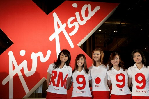 Malaysian budget carrier AirAsia stewardess pose during the launch of AirAsia X in Kuala Lumpur on January 5, 2007.—AFP file pic