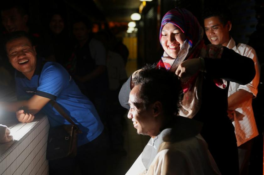 Azmina spends more than two hours cutting hair for the less fortunate on a single night, once every fortnight in the city centre. — Pictures by Choo Choy May