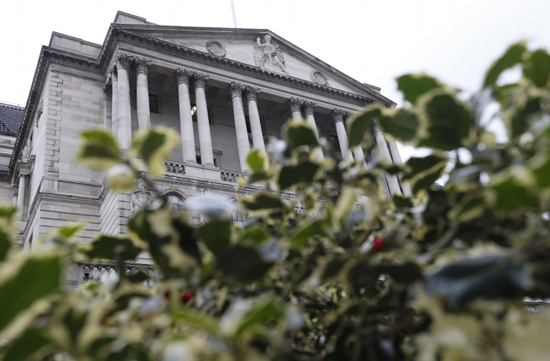 The Bank of England is seen behind holly bushes in the City of London March 15, 2013. — Reuters pic