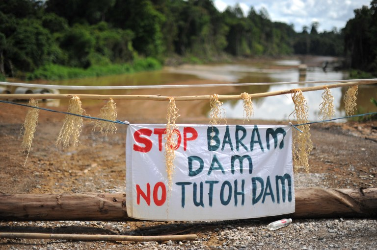This picture taken on November 16, 2013 shows a banner reading 'Stop Baram Dam' are seen on the main entrance near the first blockade camp of the proposed dam on the Baram River in Long Lama, in Sarawak. — AFP pic