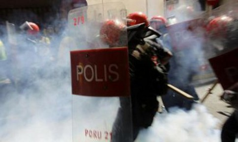 FRU police are seen engulfed in their own tear gas during Bersih's third rally in April 2012. – Reuters pic